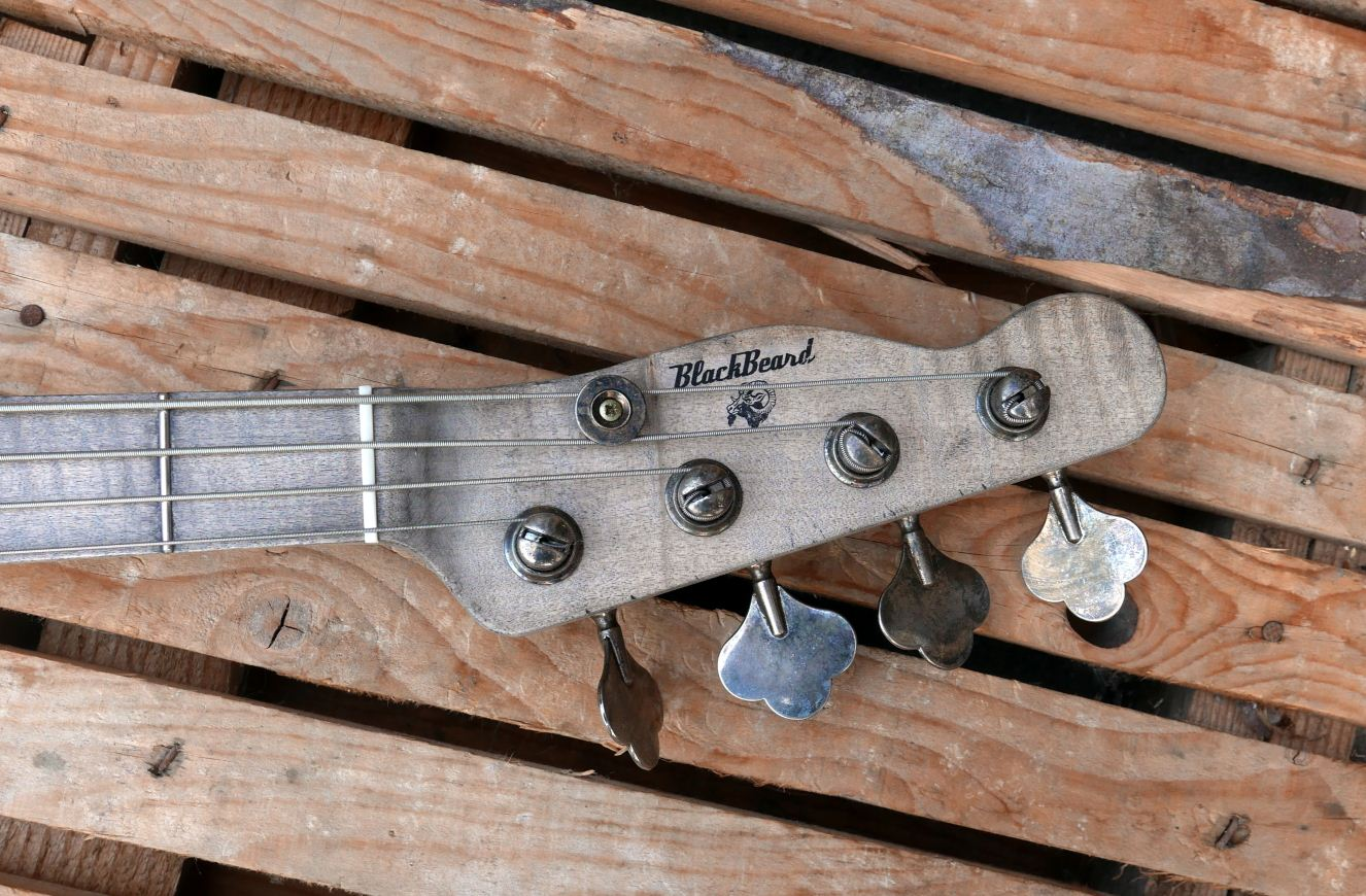 precision bass old wood headstock